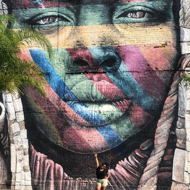 Chyna Johnson in front of a mural in Little Africa in Rio de Janiero while studying in Brazil with HIEP in 2019